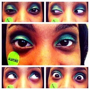 Green and black eyeshadow with green eyeliner.
