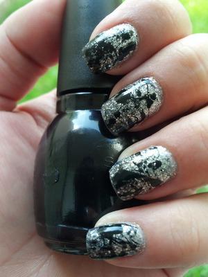 Black polish splattered over silver glitter gradient. Inspired by http://lucysstash.com/2012/10/gradient-nails-with-splatter-nail-art.html?m=1