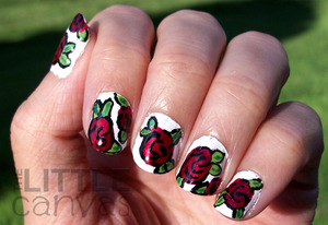 http://thelittlecanvas.blogspot.com/2012/09/31-day-challenge-day-1-red-nails.html