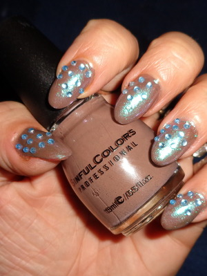 dirt brown polish with a white sparkle and some random blue stones....equals awesome