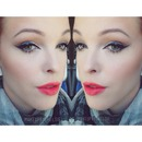 Coral lips and dramatic wing