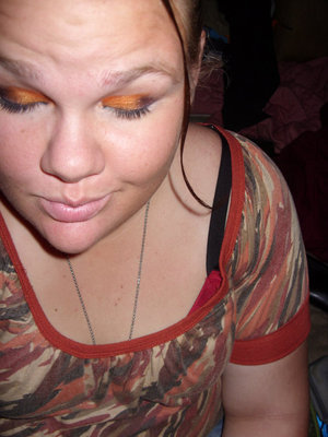 This is Orange, Purple, and there is some red in there if you can see it. When I worked at Busch Gardens this was the look I created inspired by their Summer Nights theme