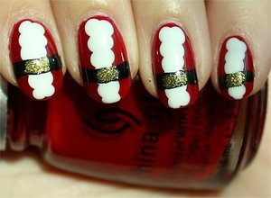 Nail tutorial & more photos here: http://www.swatchandlearn.com/nail-art-tutorial-santa-nails/