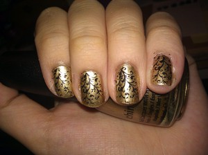I wore this to my homecoming dance at my high school. Every year, I try not to succumb to teenage peer pressure and wear trashy clothes. Ahaha. I love this. It is China Glaze Passion, love the gold on its own but I especially love it as a background color for my faux-nad stamping.