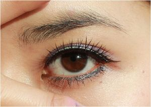 Wearing glitter band false eyelashes. They make getting dolled up for New Year's so much easier!