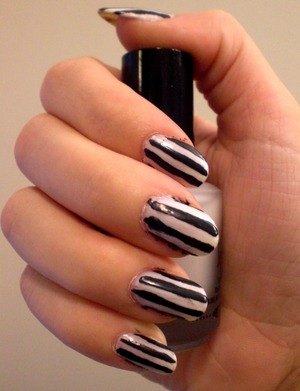 Black on Black by sinful colors and Polar Bare by Sally Hansen Salon perfect manicure.  Stripes created with masking tape.