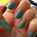 Green with yellow flowers nails 💅❤
