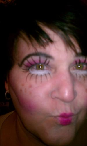 this is my mom :D i tryed doing goldie starlings  creepy doll look ;)