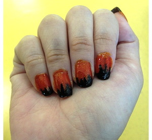 Hi! Here was my halloween nail design last year. I did this last year and I was probably too excited so my cuticles still had polish on them. Haha! There isnt a specific design to this. I thought the black spikes was something like cat claws. Its really up to your imagination to assume what it is. Haha!