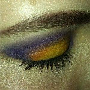 Purple, yellow and orange eyeshadow with black eyeliner and black mascara