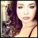 big eye makeup/big curly hair