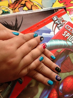 Punisher, batman, captain America, pow. Comic book nails with blue anime/cartoon nails
