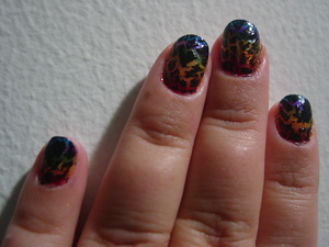 OPI shatter in black  over Rainbow.  All the colors of the rainbow are from Sinful Colors.  :)  yes I still needed to clean the edges.  I know!!