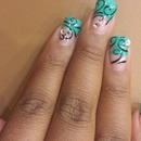 Teal nails with swirls