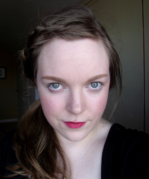 This is me fairly natural. A small amount of foundation, fairly strong brows, no eye make up, and pink lips.