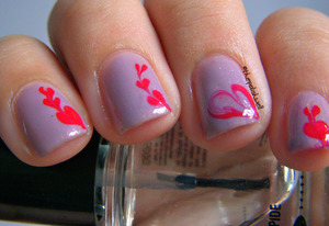 Another Valentine's Day mani - needle marbling hearts! http://thepolishwell.blogspot.com/2012/02/nail-ideas-hearts.html