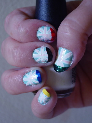 pastel british flag with french tips in Olympic colors complete salon manicure - barracuda (blue) sinful colors - snow me white sinful colors - easy going (pink) sinful colors -  ruby ruby (red) sinful colors -  midnight blue  sinful colors -  black on black Ulta  - envy (green)  sally hansen insta dry - Lightening