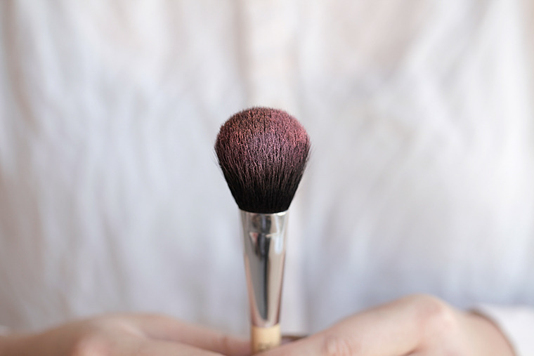 Cleaning powder makeup brushes is best with spray