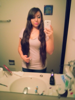 This is how long my hair is now. Its down to my thighs.. but I'm going to chop it off soon :))
