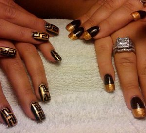 hand painted with 14k gold polish freehand french tips and versace logo