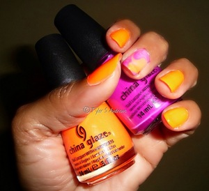"(Right Hand) --- Using China Glaze's ""Under The Broadwalk"" & ""Orange Knockout"".  Mummy's early Mother's Day treat --- Mani with Marble Nails :)"