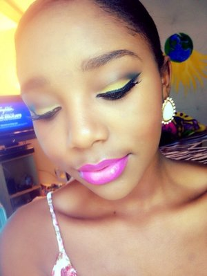 Yellow and black lids and a bright pink lip