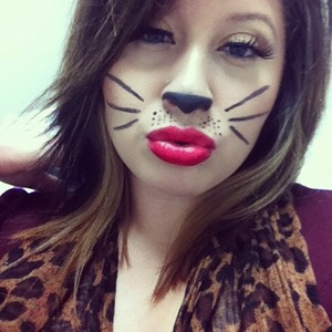 Last Halloweens Look.  Use your imagination. This look was so fun. Research on what RedLip you are, Not All red colors fit any complection.  Im Fair/Light so i use HotRed, Have Fun Dolla