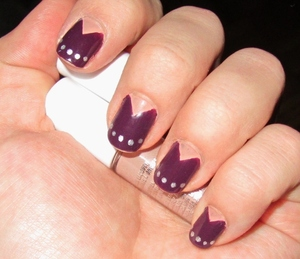 Fun, edgy style for a different take on spring.  Blog post here: http://rivuletsbeauty.blogspot.ca/2012/04/notd-studded-reverse-mani.html