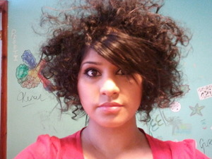 To keep the hair look afro and wild add hair serum and hair spray