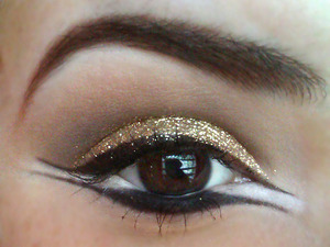 "Glitter eye, brown cut-crease and separated top and bottom liner with white ""filling""."