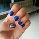deep blue and gold nail art.
