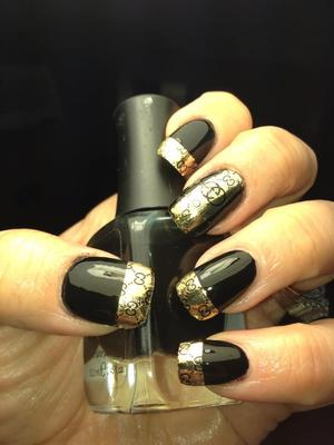 simple gucci design using nail covers that I cut into shapes =)