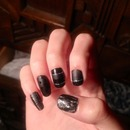 Black matte and shiny nails with textured thumb