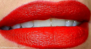 A beautiful, balanced red matte lip color.