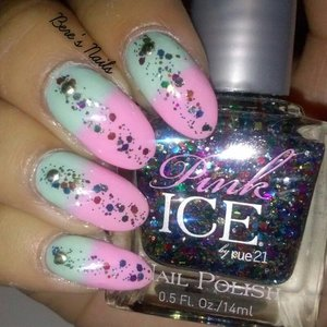 Pastel tea and pink gradient with a multi-colored glitter stripe in the middle. Accented with round gold studs.