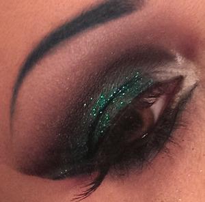 Dark, smoky eye with green glitter