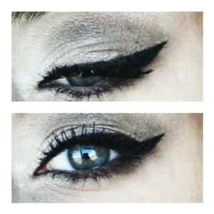 Cat eye with brown eye shadow.