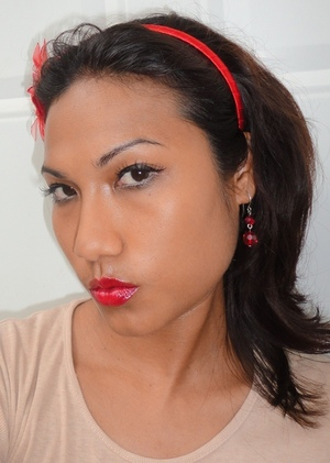 Try a classic red lip with MAC Russian Red lipglass: http://chinadolltt.blogspot.com/2012/05/to-russia-with-love-from-mac-russian.html
