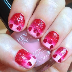 A sweet and sassy manicure for Valentine's day with all the trimmings and my first try at a gradient nail. I also added a little sparkle and some sequin-like hearts I just got from dollarnailart.com to complete the lovey-dovey effect.  http://michtymaxx.blogspot.com.au/2013/02/be-my-valentine.html