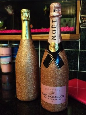 Glitter champagne bottles I decorated for my brothers wedding :-)