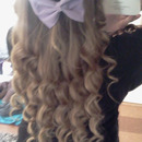 Curled hair with purple bow