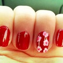 Red nails with pink flowers :)