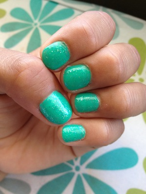Went to get a mani and pedi and I loved how it turned out. Such a great summer color! The touch of sparkles made it 10 times better. Love it !