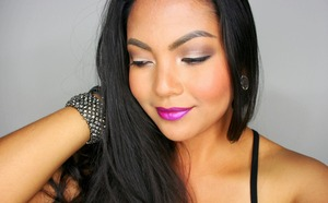Wearing a bold violet lip color with neutral eyes. Great for fall.