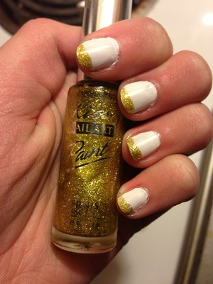 Used OPI Alpine Snow and Kiss Nail Art Paint in a sparkly gold colour.