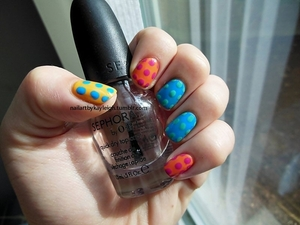 "more bright, graphic pop art style nails  OPI in The ""It"" Color, Sally Hansen Xtreme Wear in Sun Kissed, Sally Hansen Xtreme Wear in Blue Me Away!, Essence in Ultimate Pink, and Barielle in Do Unto Others."