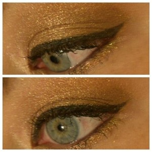 Blended out gold cat eye look.