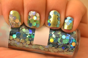 the nail color is Bling Cosmetics in Cleopatra Gold.