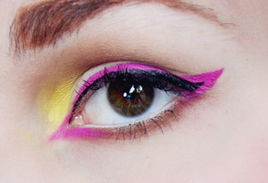 """I felt like playing with colour, and I have a neon pink liquid liner that I have never used so I figured I'd put it to use for this look! The overall look of this was very much inspired by YouTube guru NikkieTutorials' """"Neon Nights Tutorial""""!"""