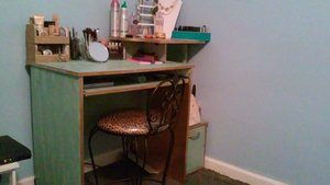 my husband got tired of my makeup being in the restroom so he bought me a desk (less than $20/craigslist).. he did all the painting and I love how it came out.. the gold thing in the corner is a tape dispenser that was damaged and got it really cheap @ Michael's. .along with the white necklace holder... jewelry rack. and lipstick holder from eBay..small glass cups from Wal-Mart. .mirror from grocery store  and the leopard print chair from Ross